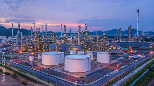 Fotografia  Aerial top view oil and gas chemical tank with oil refinery plant background at twilight