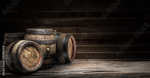 Wine barrels on the old wooden table.