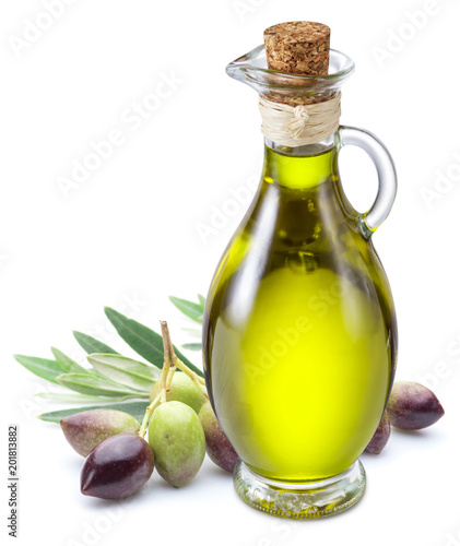 Bottle of olive oil and olive berries on white background.
