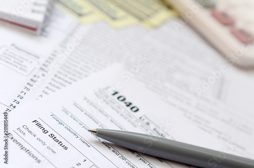 Printed kitchen splashbacks Newspapers The pen, notebook, calculator, and dollar bills is lies on the tax form 1040 U.S. Individual Income Tax Return. The time to pay taxes