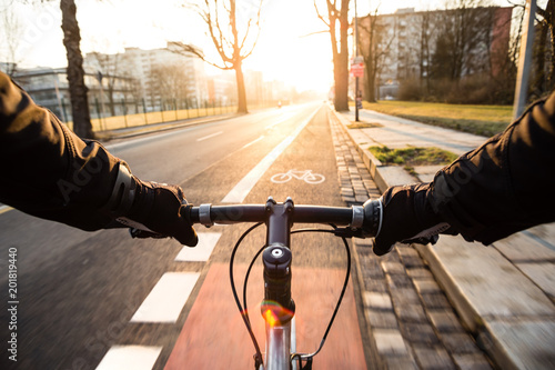 Fotografie, Obraz  First-person view of cyclist in the city at morning