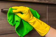 Hand In Glove With Green Rag I...