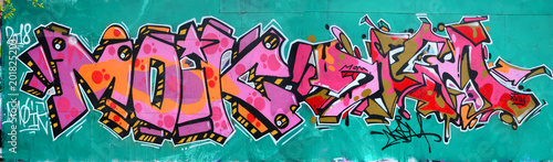 plakat Fragment of a beautiful graffiti pattern in pink and green with a black outline. Street art background image