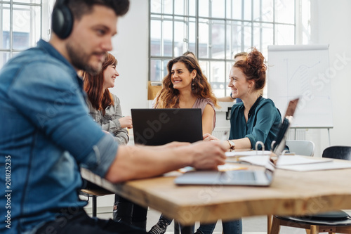 Fototapety, obrazy: Group of young people working or studying together