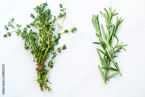 Fotografía  Bunches of tied thyme and rosemary on white background isolated