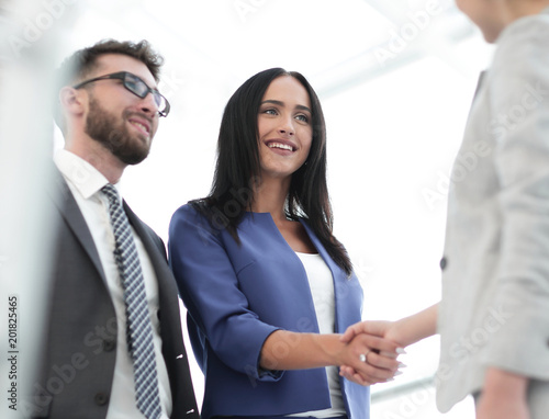 Businesswomen Shaking Hands In Modern Office Wallpaper Mural