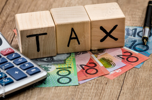 Wooden Cubes With Text Tax Australian Dollar Pen And Calculator