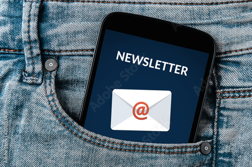 Subscribe newsletter concept on smartphone screen in jeans pocket. All screen content is designed by me. Flat lay