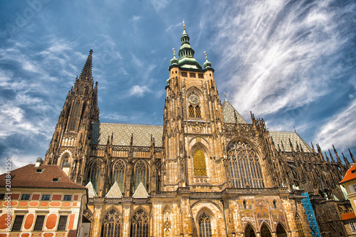 Staande foto Praag St.vitus cathedral in prague, czech republic. Church building on cloudy blue sky. Monument of gothic architecture and design. Vacation and wanderlust concept