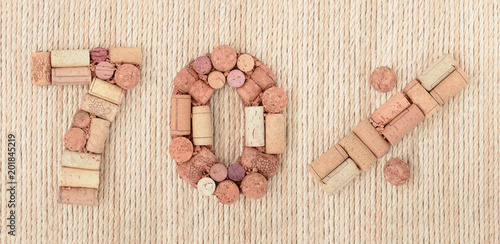 Poster Number seventy 70 %  percent made of wine corks on sea twine background