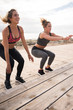 Pretty healthy women doing fitness exercises