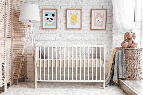Modern baby room interior with crib Fototapet