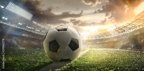obraz dibond Sport. Soccer ball on stadium. Football poster.
