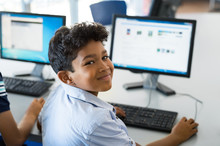 School Boy Using Computer