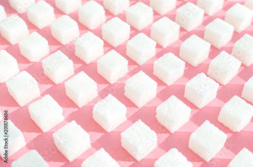Foto Refined sugar on pink background