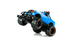 Blue RC SUV Off Road Truck Car (Radio-controlled) Take Wheelie Ready For Race Isolated On White Background. (This Toy Has Some Dust From Children Playing)