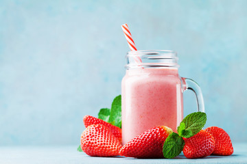 Pink strawberry smoothie or...