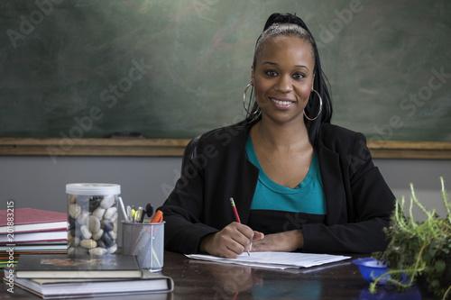 Vászonkép Portrait of a black female teacher at her desk