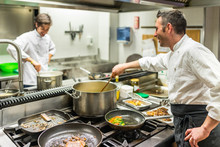 Chef And Cook At Work In A Res...