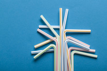 Plastic Straws On A Blue Backg...