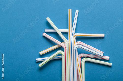Fotografie, Obraz  Plastic straws on a blue background