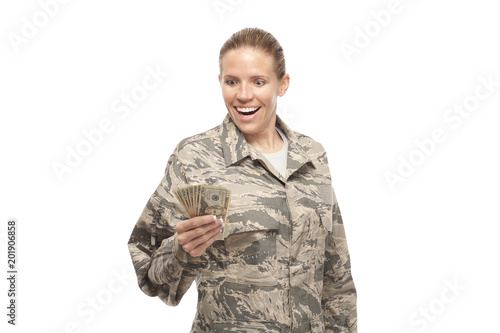 Excited female airman with money Canvas Print