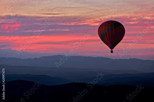 Recess Fitting Balloon Aerostatic balloon with a red sunset in the background