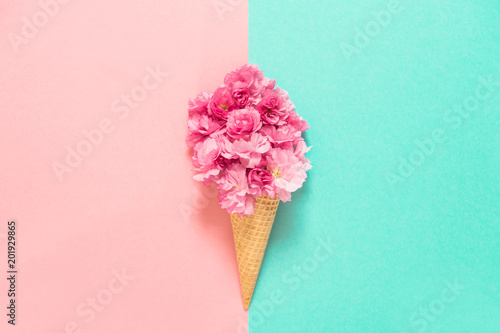 Cherry tree blossom in ice cream waffle cone Pink flowers