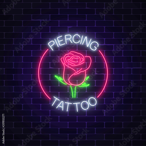Fényképezés Tattoo and piercing parlor glowing neon signboard with rose emblem