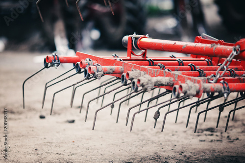 Fotografia, Obraz steel roller for a harrow stands in the field for agricultural work in the sprin
