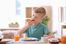 Cute Little Boy Eating Tasty T...