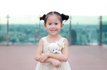 Portrait Of Happy Child Girl W...