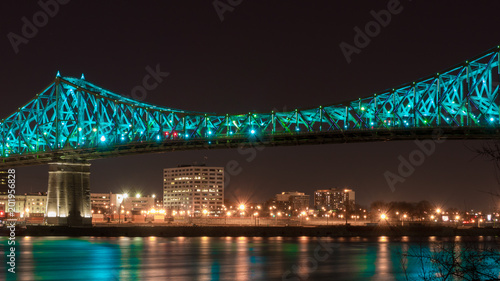 Long exposure shot of Jacques Cartier Bridge Illumination in Montreal, reflection in water Canvas