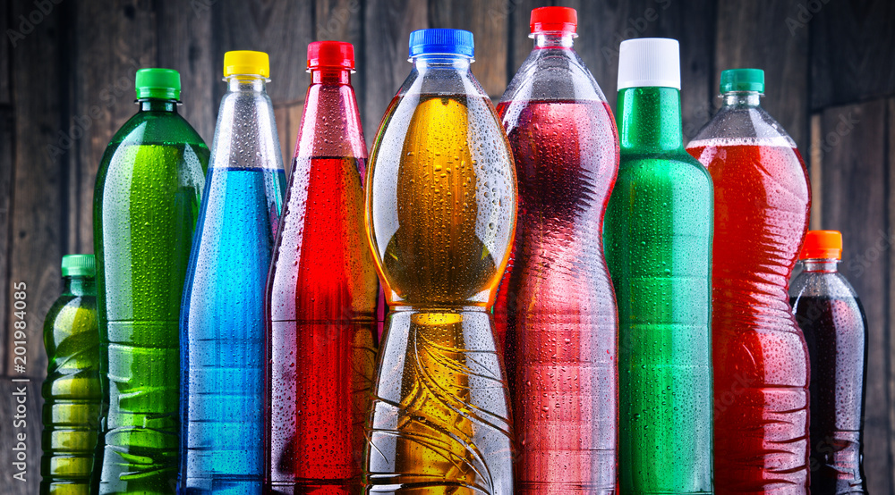 Fototapeta Plastic bottles of assorted carbonated soft drinks