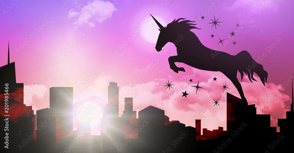 Unicorn silhouette jumping over city
