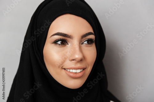 Portrait closeup of muslim prayer woman 20s in religious headscarf with oriental Canvas Print