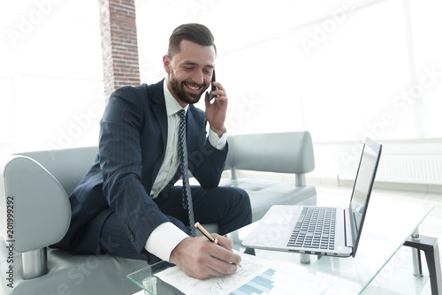 Garden Poster Businessman discussing on a smartphone, business issues