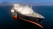 canvas print picture - A small tanker on the roadstead bunkers a large LNG tanker.