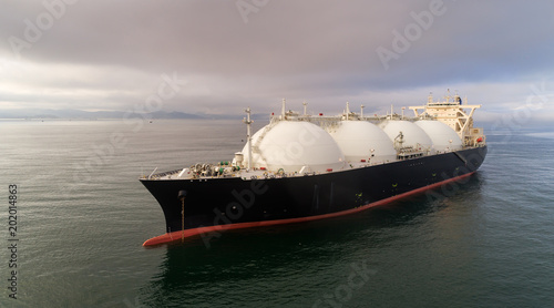 LNG-tanker at anchor in the road.
