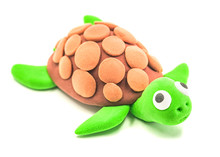 Plasticine Cute Green Turtle Isolated On A White Background