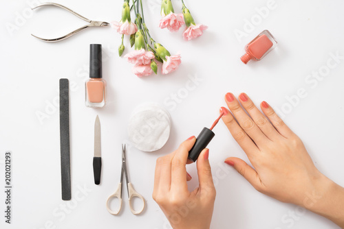 Aluminium Prints Manicure Women's hands with tools for manicure. Nail care.