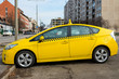 modern taxi cab in yellow color view from the side