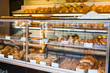 glass shelves with fresh bread and buns in the bakery