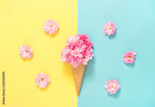 Cherry blossom ice cream waffle Pink flowers Floral flat lay