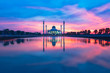 Leinwanddruck Bild - beautiful reflection mosque building shot during sunset or sunrise