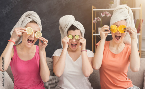 Fotografie, Obraz  Three beautiful girls covering eyes with fruit pieces