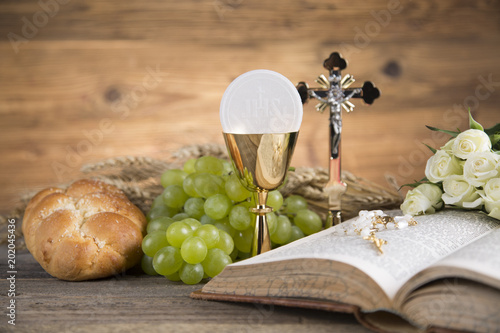 Fototapeta Eucharist symbol of bread and wine, chalice and host, First communion background obraz