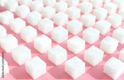 Fototapeta Refined sugar on pink background