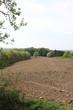 Acker in der Landschaft vor der Bewirtschaftung des Feldes