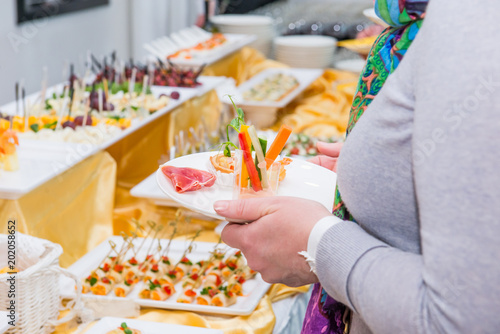 Poster Pharmacie Catering buffet table with food and snacks for guests of the event. Group of people in all you can eat. Dining Food Celebration Party Concept. Service at business meeting, weddings. Selective focus.